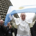 Pope Francis holds up Argentina's flag outside cathedral during World Youth Day visit to Brazil